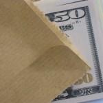 1384589_brown_envelope_money_bribe_1